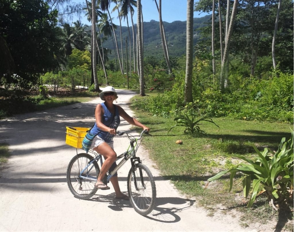The Backpacking Housewife exploring the island of La Digue in Seychelles by bicycle