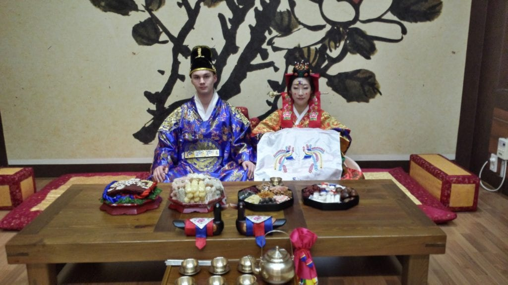 The Bride and Groom wear traditional ceremonial clothing for The Korean Pyebaek Tea Ceremony
