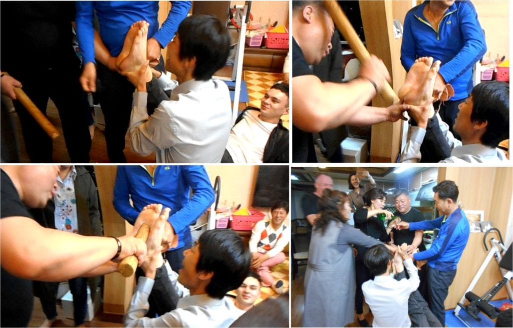 Korean Feet Beating: Beating the groom's feet and the beaters are rewarded with a drink by the bride's mother!