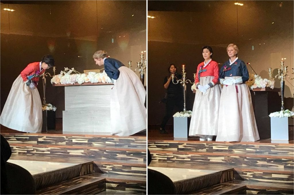 The two mothers start the ceremony with respectful bowing to each other and to the guests