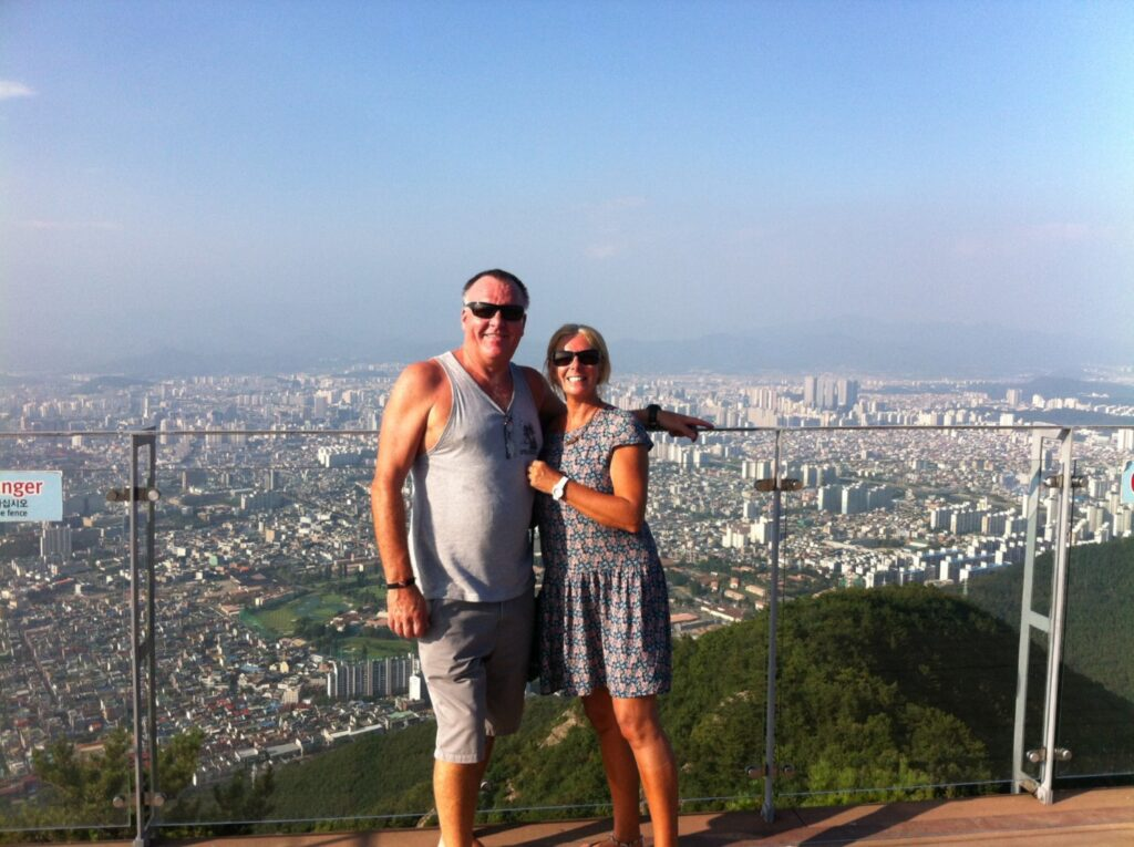 The Backpacking Housewife and Backpacking Husband on the observatory platform at the top of Apsan Mountain
