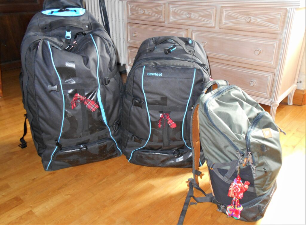 The best of all worlds! Light backpacks with pull out handles and wheels.